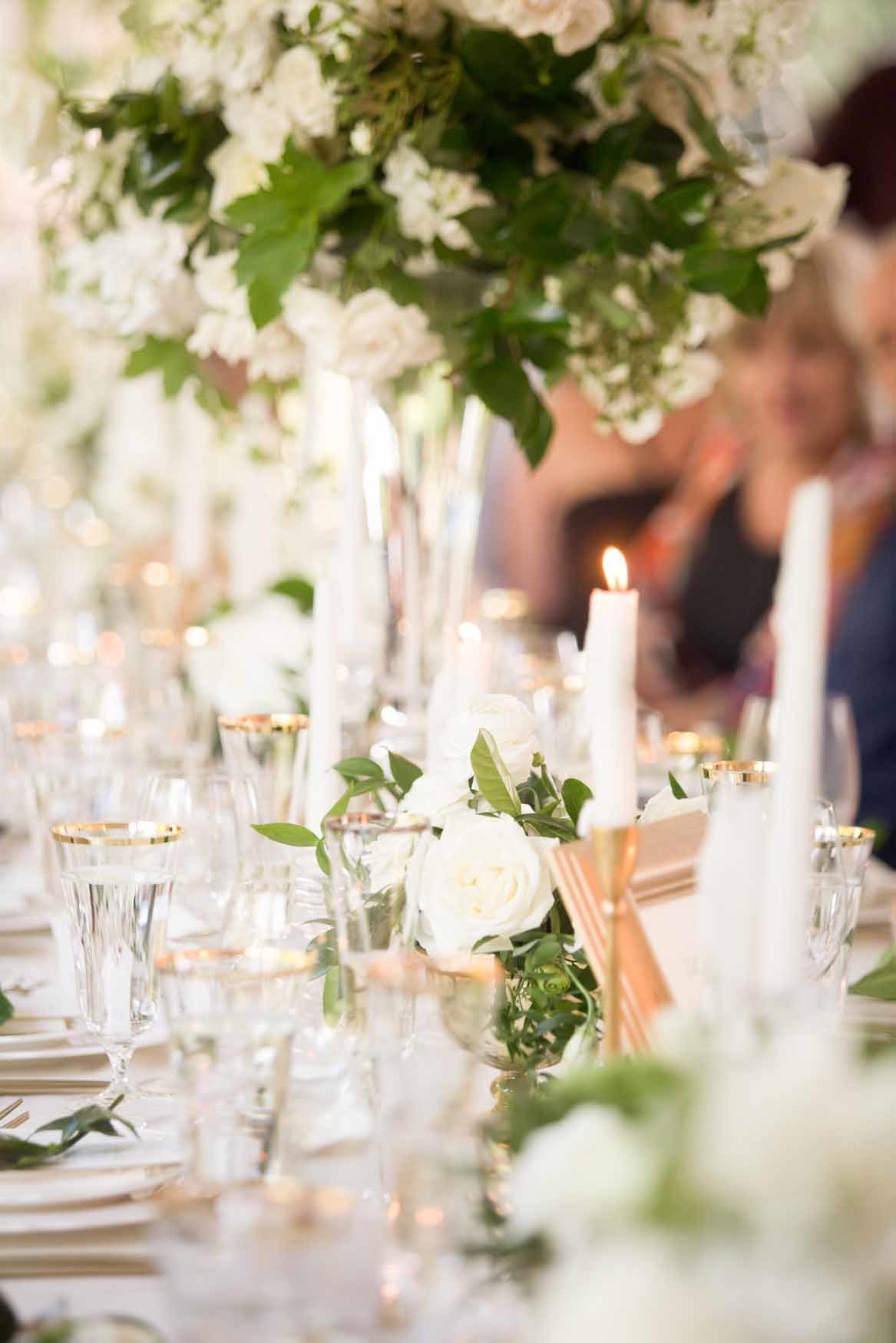 Tall garden style white and green arrangement with candles