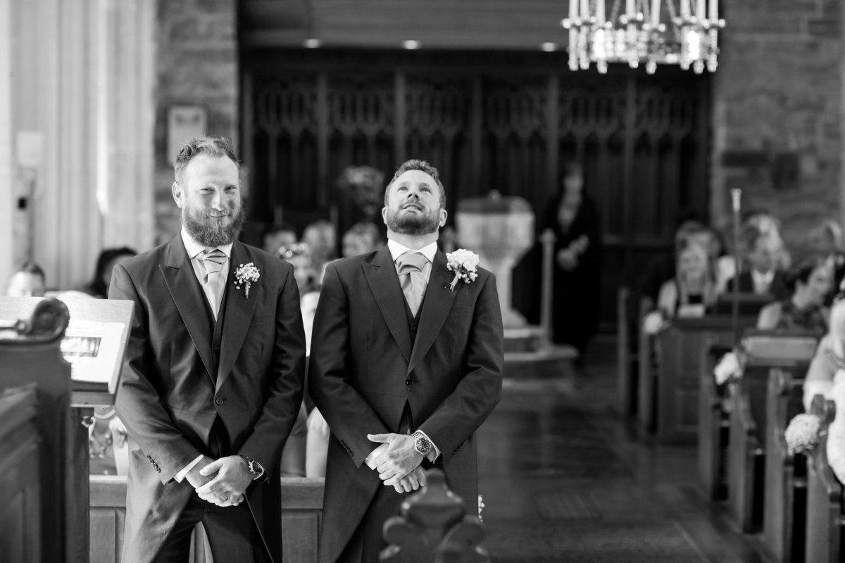 groom waiting in church black and white devon wedding