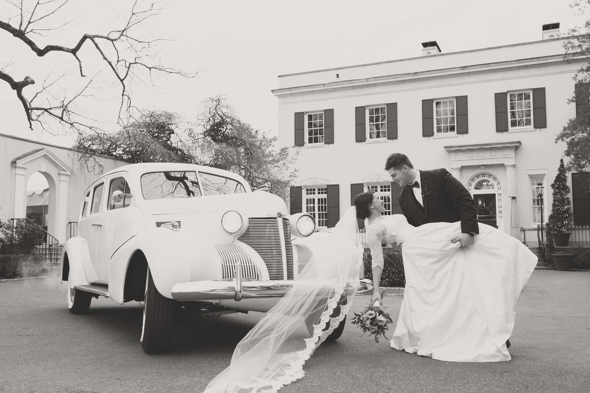 Bride and groom next to their wedding vintage car at The Mansion at Oyster Bay