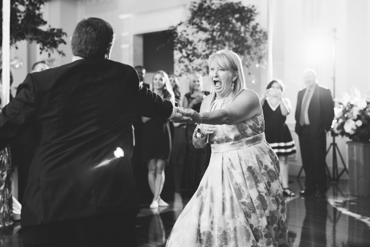 When the music hits and no one is ready for your surprise mother-son dance! Photo by luxury destination wedding photographer Rebecca Cerasani.