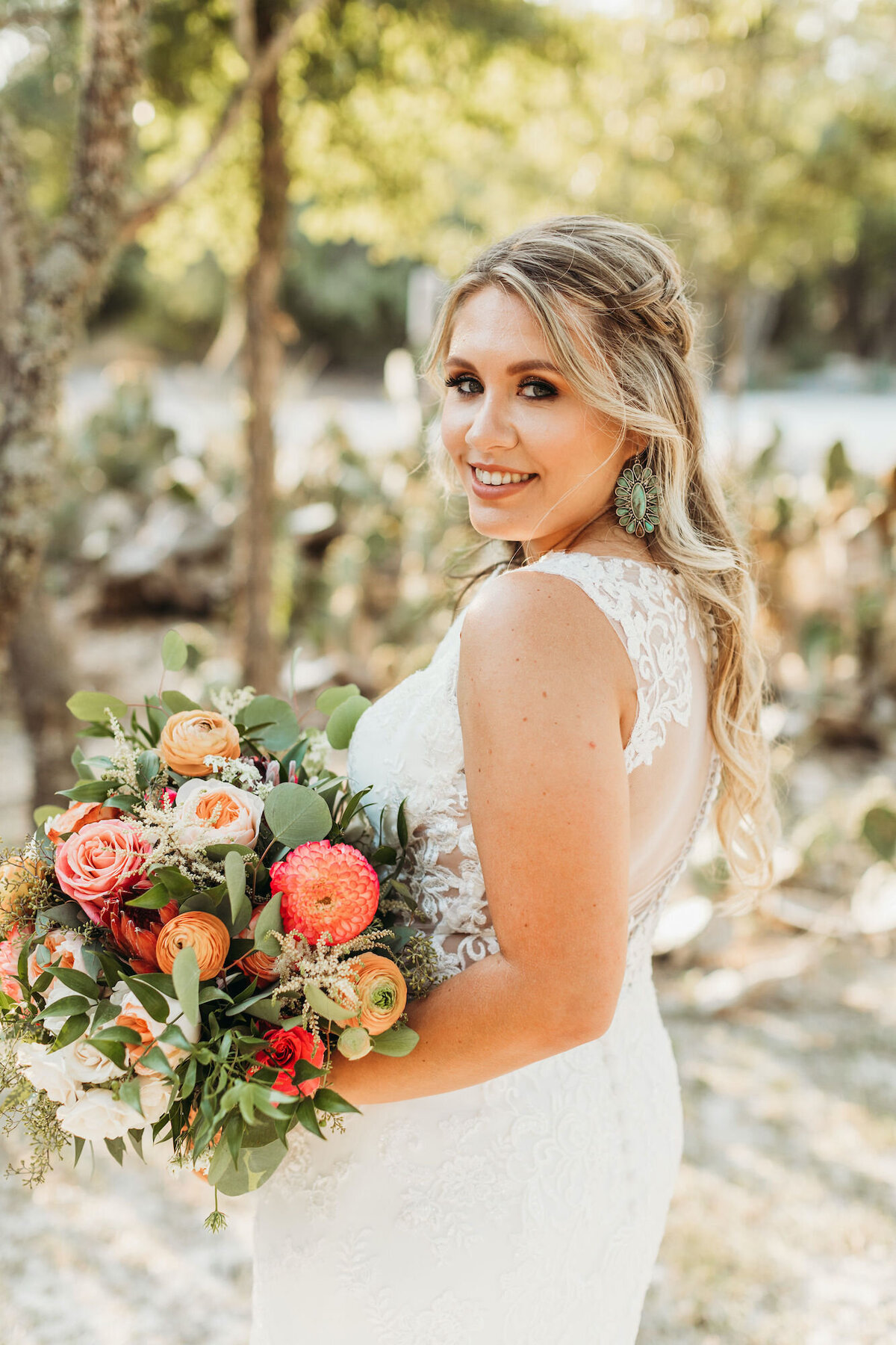 Bride with pink and orange bouquet