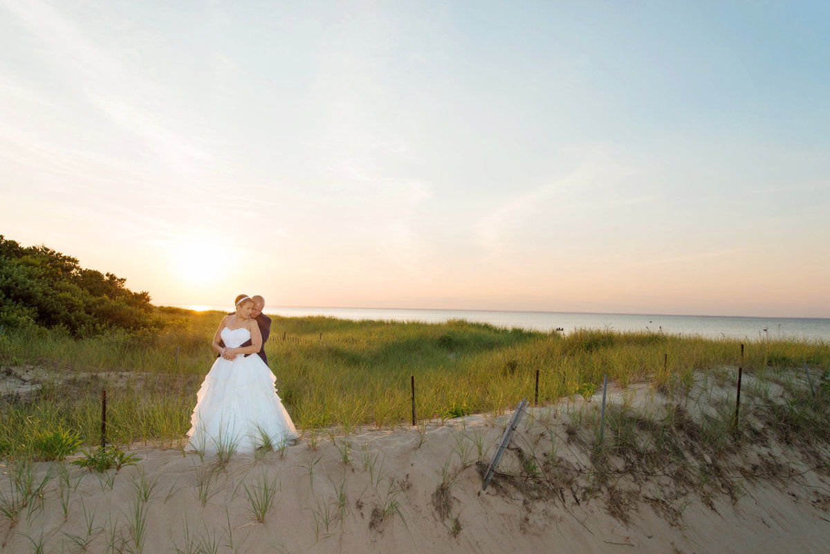 photo of bride and groom on the beach during sunset from wedding at Pavilion at Sunken Meadow
