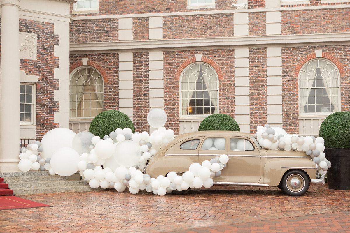 Balloon Covered Car in front of The Historic Cavalier Hotel