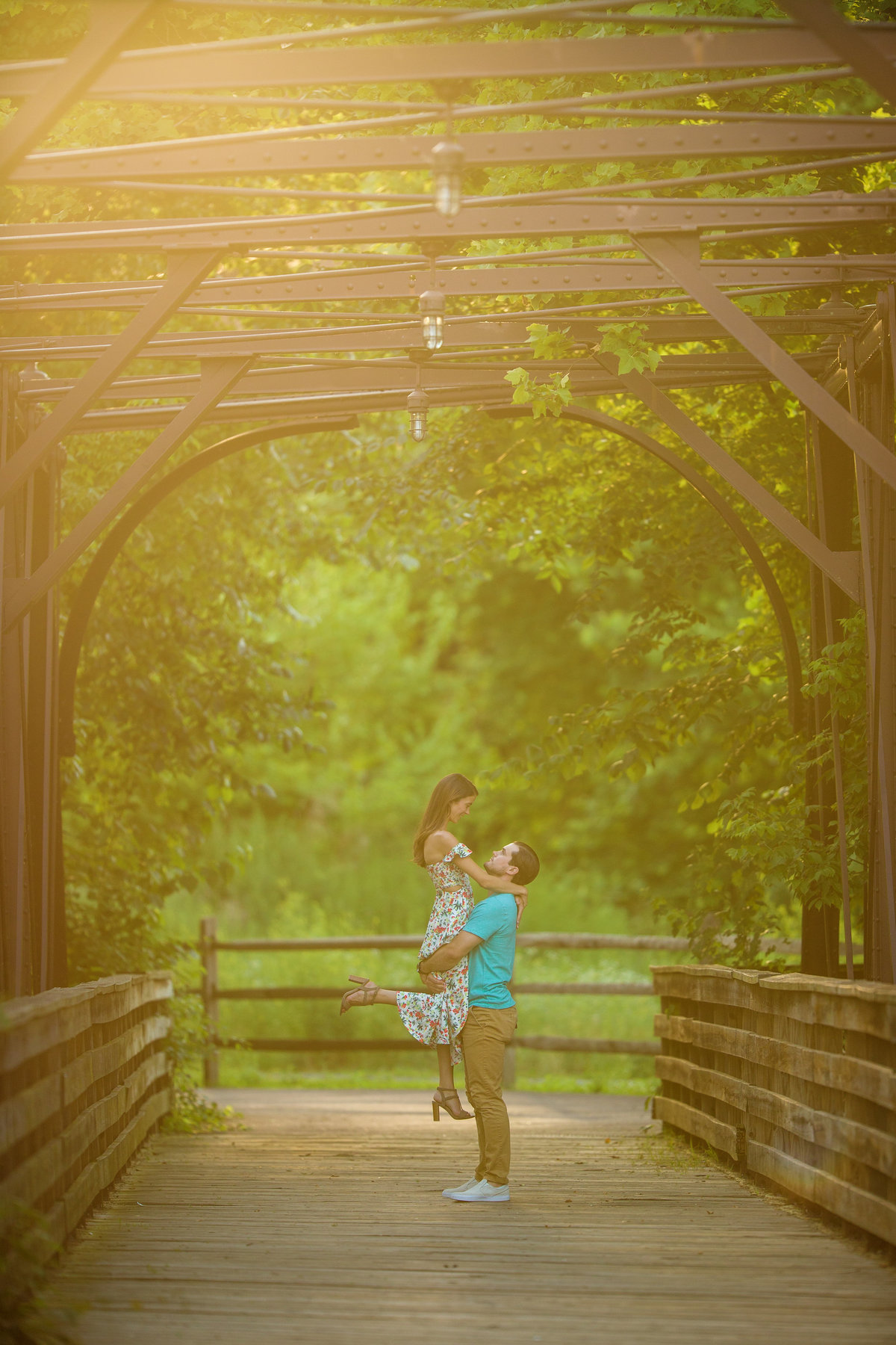 Sunflare warm romantic engagement photos