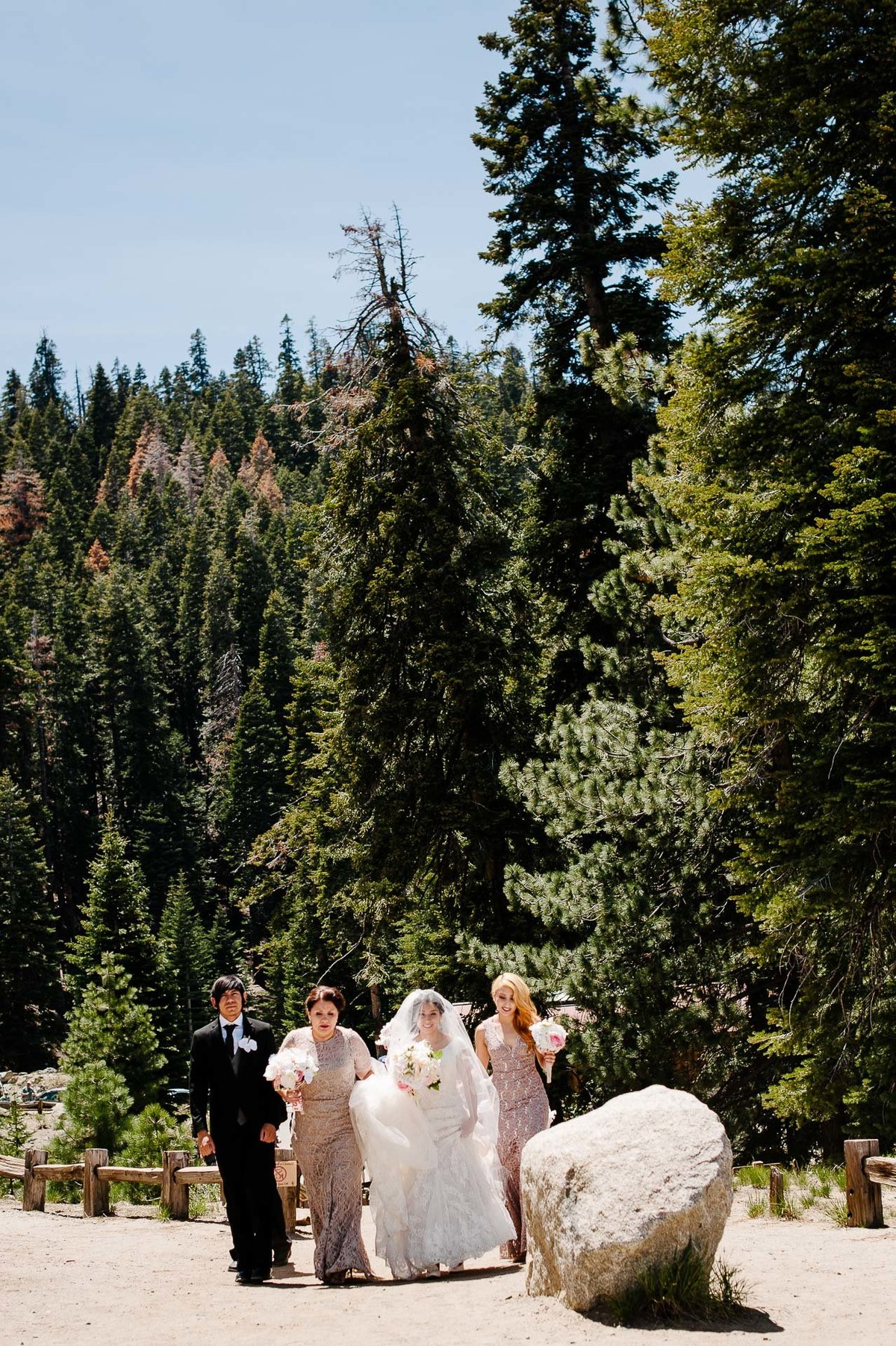 bride walking at glacier point for her WEDDING AT YOSEMITE NATIONAL PARK