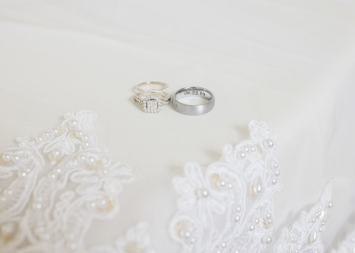 Arkansas weddings bands on lace detail / Katie Childs Photo