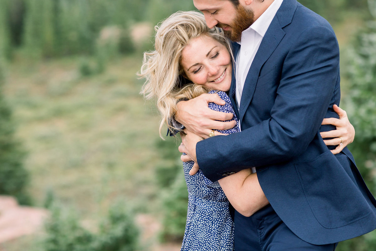 Couple embrace during Colorado engagement session