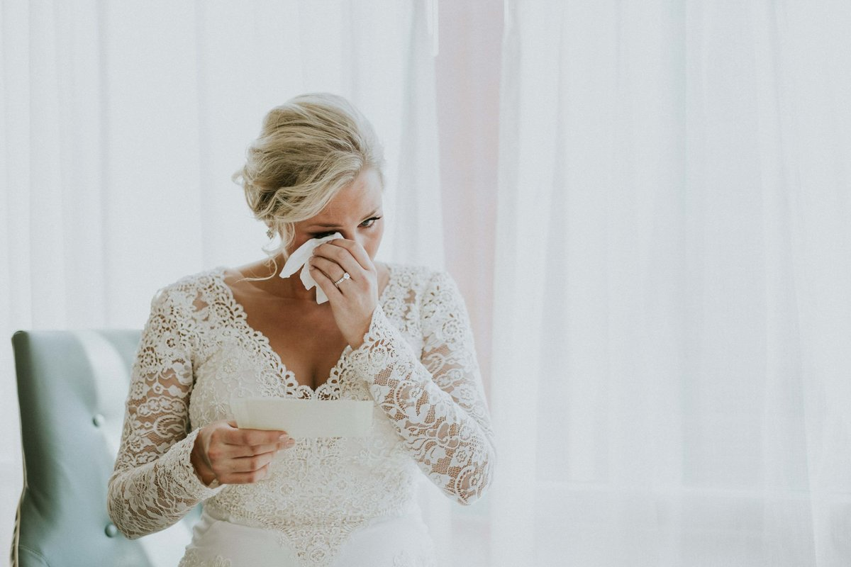 Bride wipes tears right before Scottish Rite wedding
