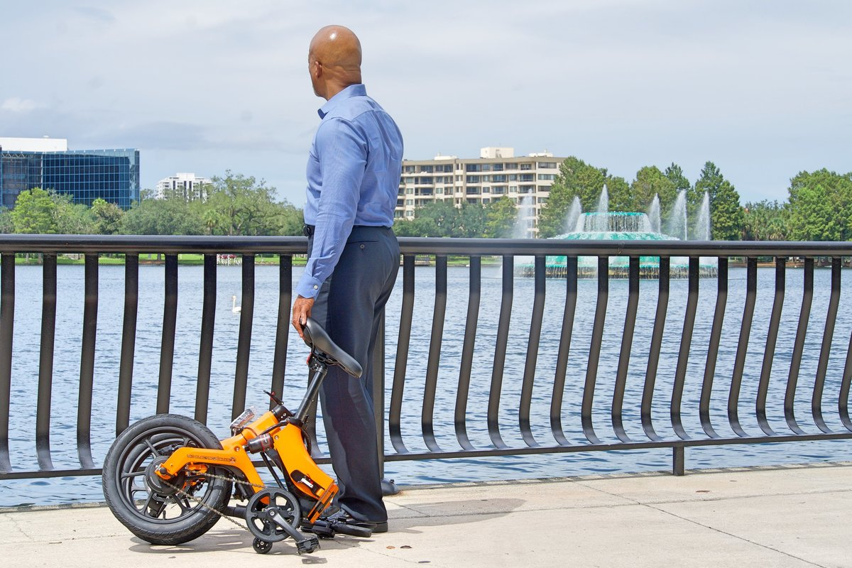 Orange Go-bike M4 Folded up on Lake Eola Orlando