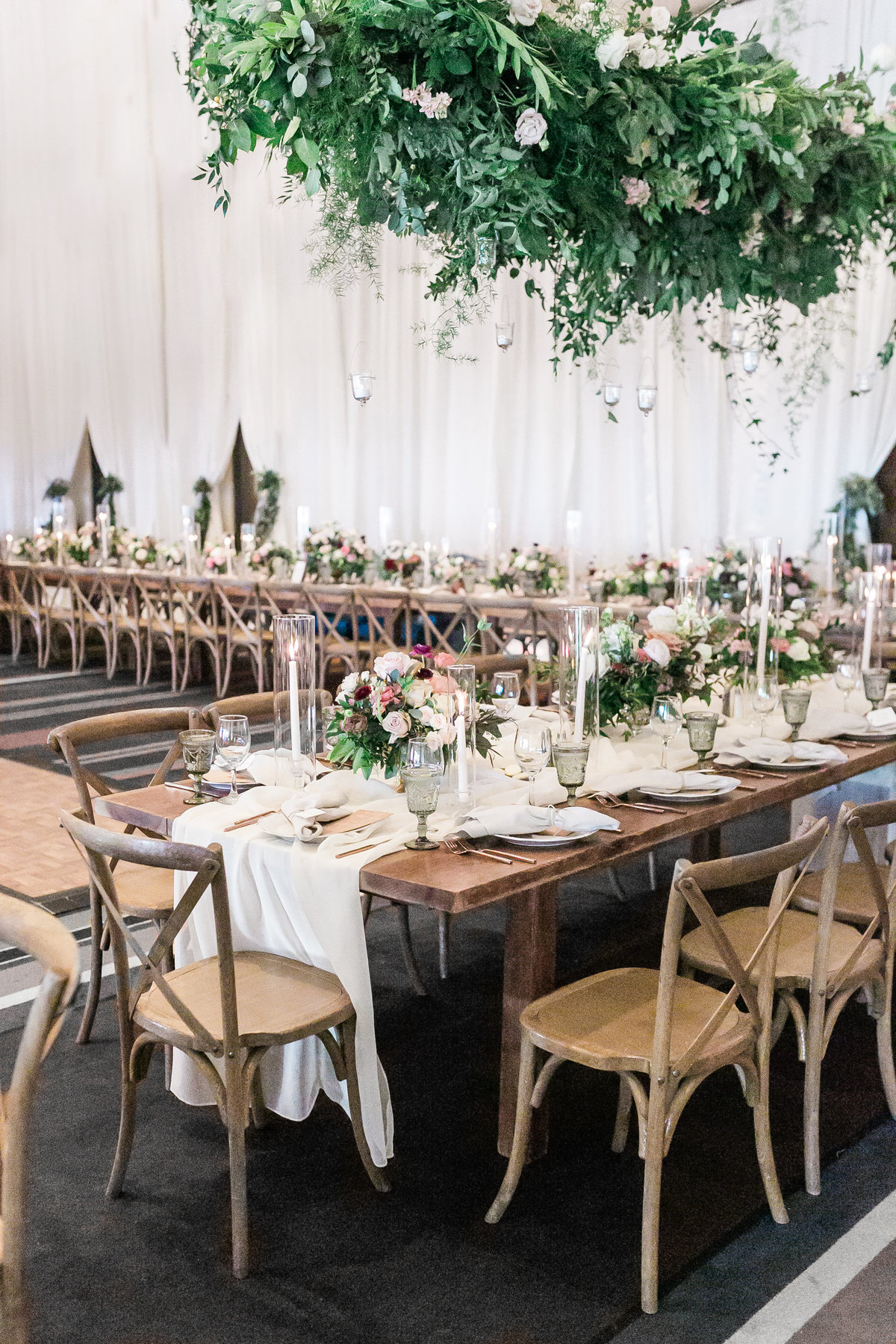 Hyatt Regency Lake Tahoe wedding in ballroom with rustic wood tables and chairs with hanging floral chandeliers