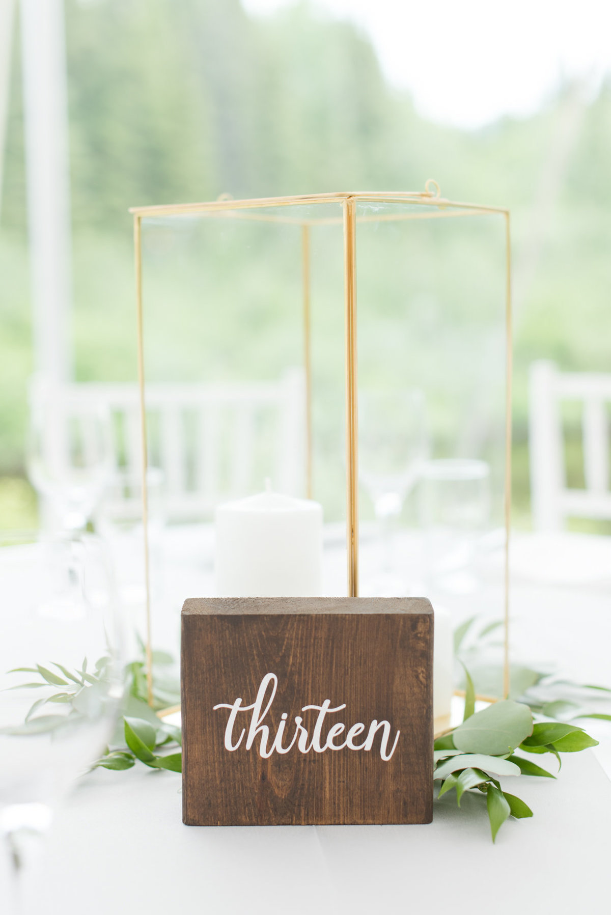 Wood and calligraphy table number from Tents & Events at Stepstone wedding in Thunder Bay