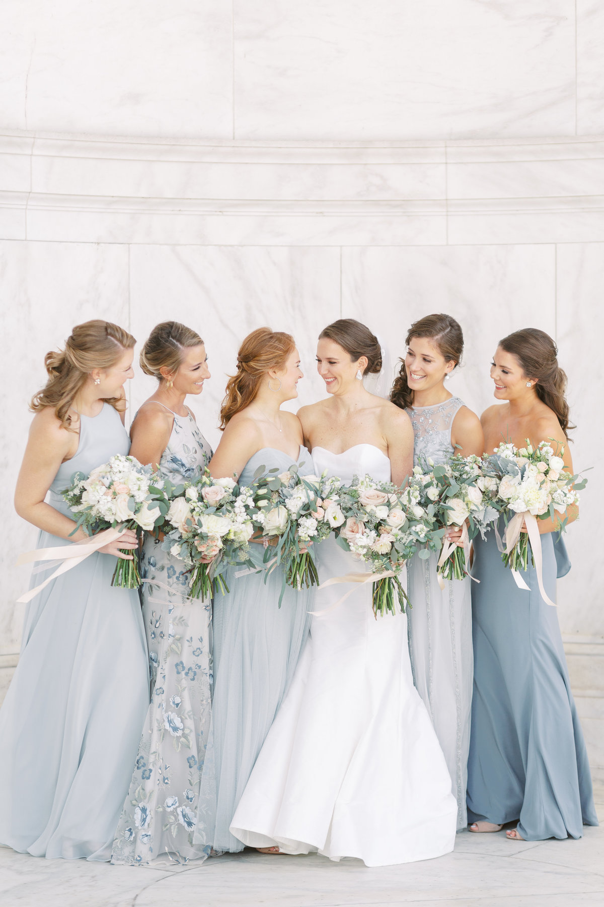 Mixmatched bridesmaids wedding at Jefferson Memorial in Washington, DC.