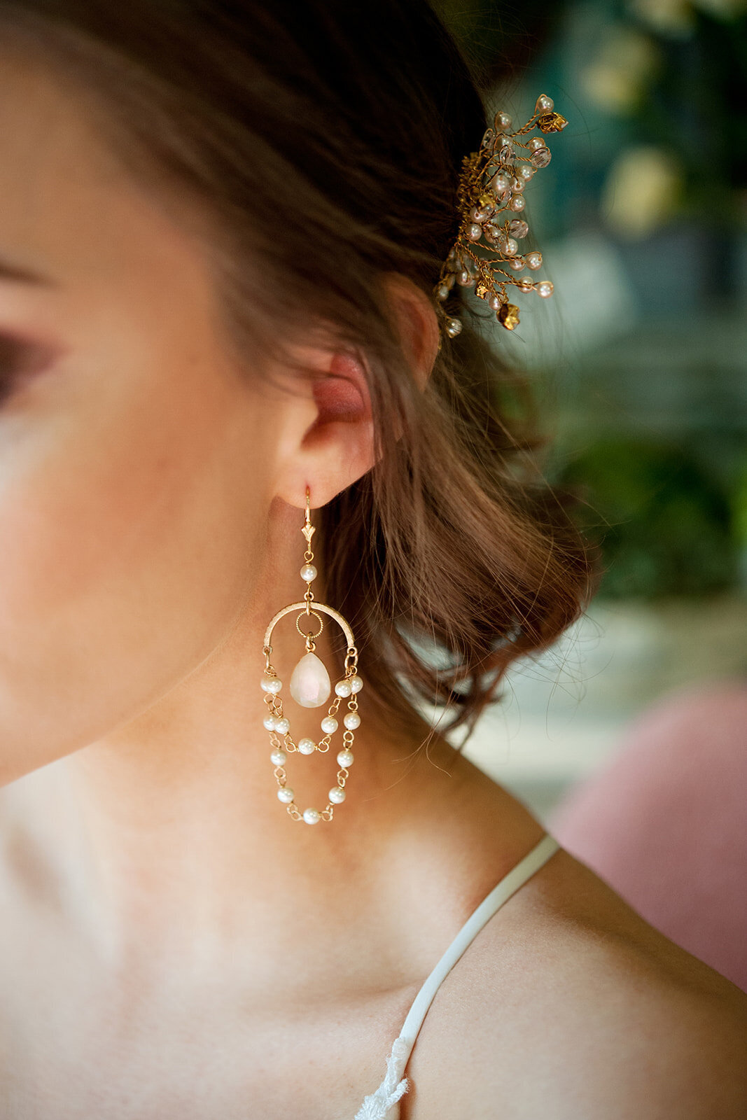 Bride wearing crystal and pearl wedding earrings by Joanna Bisley Designs