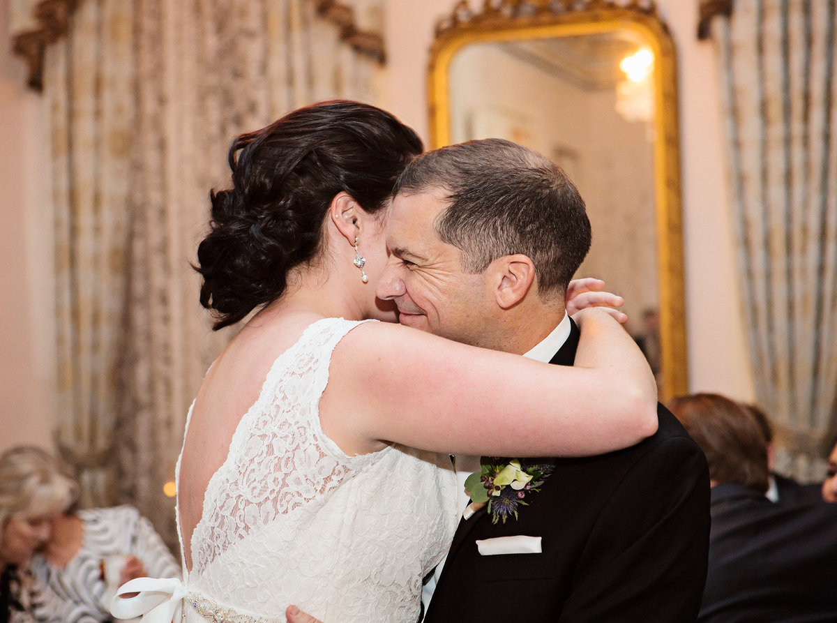 NOLA groom smiling at his bride during their first dance at The Columns Hotel