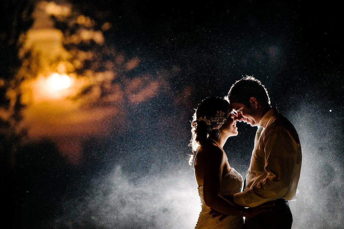 bride and groom portrait with the moon