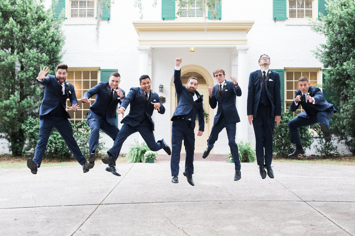 Groom and Groomsman during wedding at The Ribault Club in Jacksonville