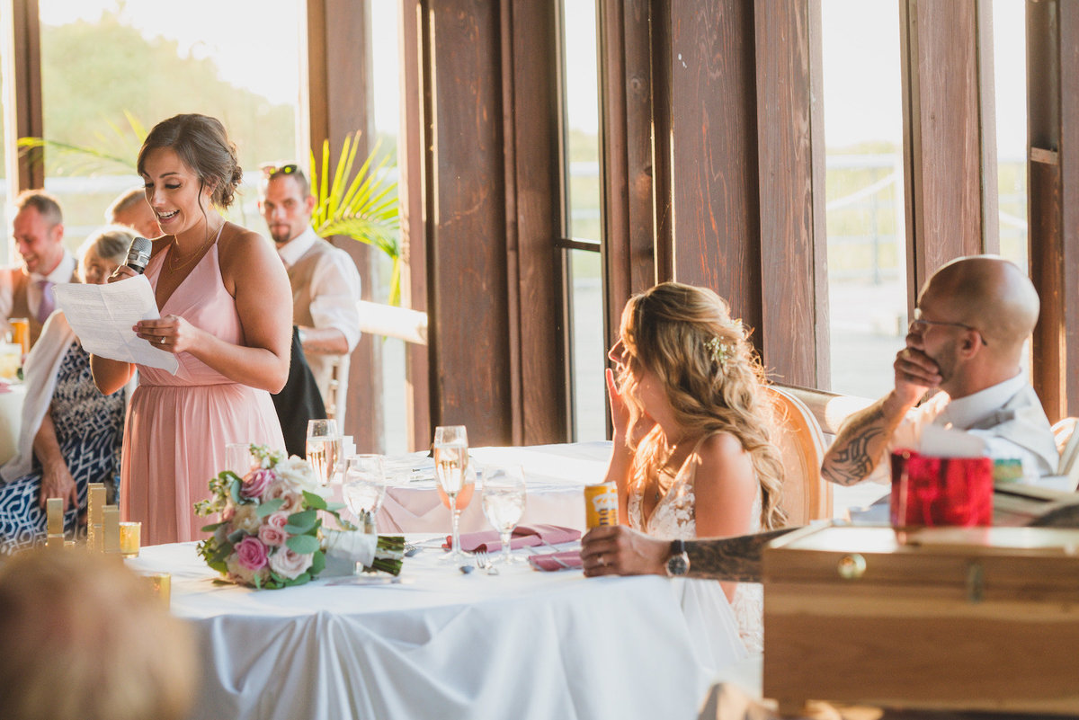 photo of maid of honor giving speech during wedding reception at Pavilion at Sunken Meadow