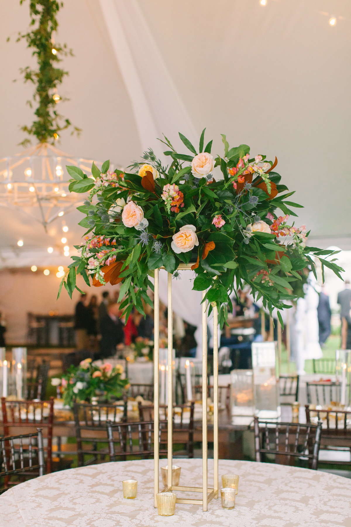 Tall Floral Arrangement on Gold Stand with Greenery  Blush Juliette Garden Roses and Magnolia Leaves