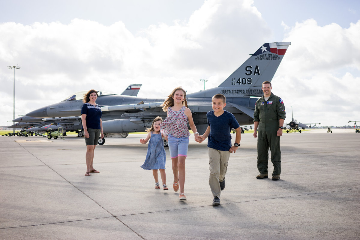 family portrait session of plane on air force base by San Antonio Photographer Expose The Heart Photography