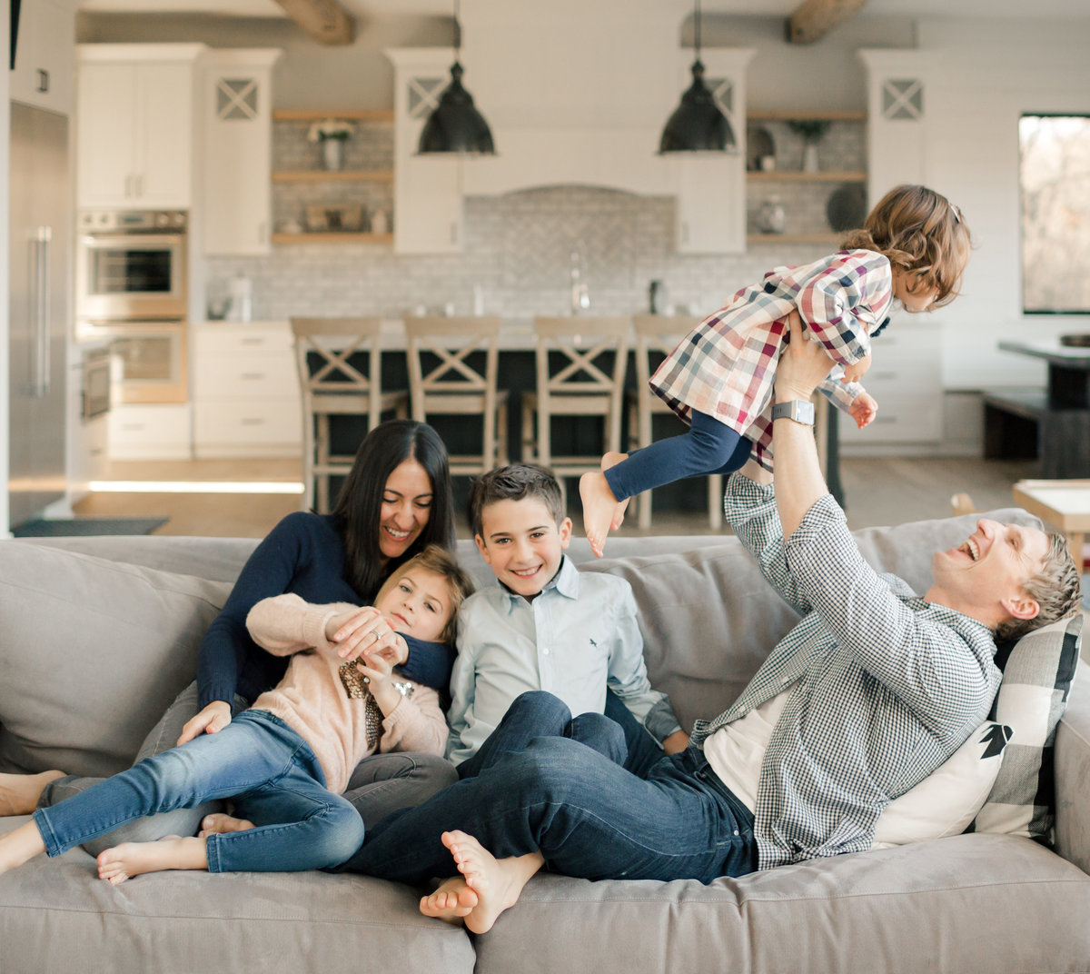 real casual family of five in their beautiful home_