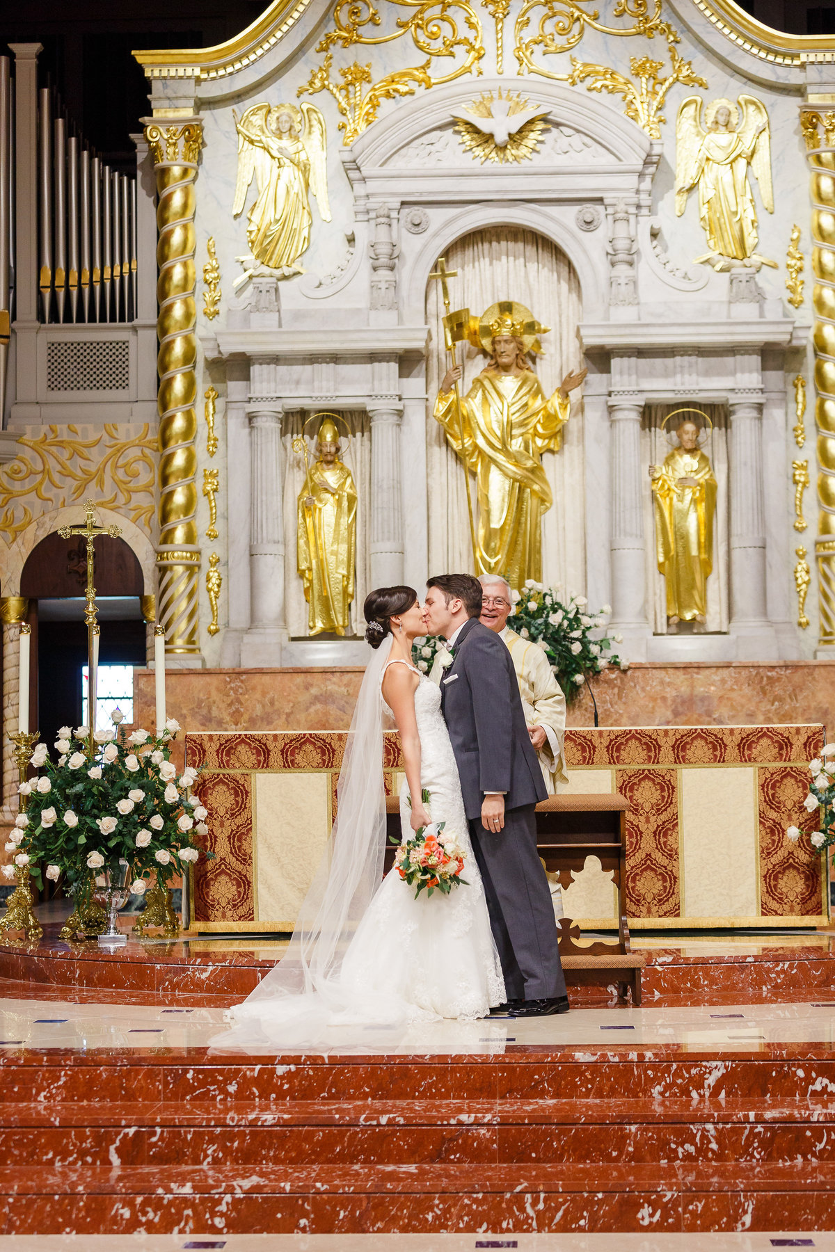 St. Augustine Wedding Couple Kiss at their Cathedral Basilica Wedding Ceremony