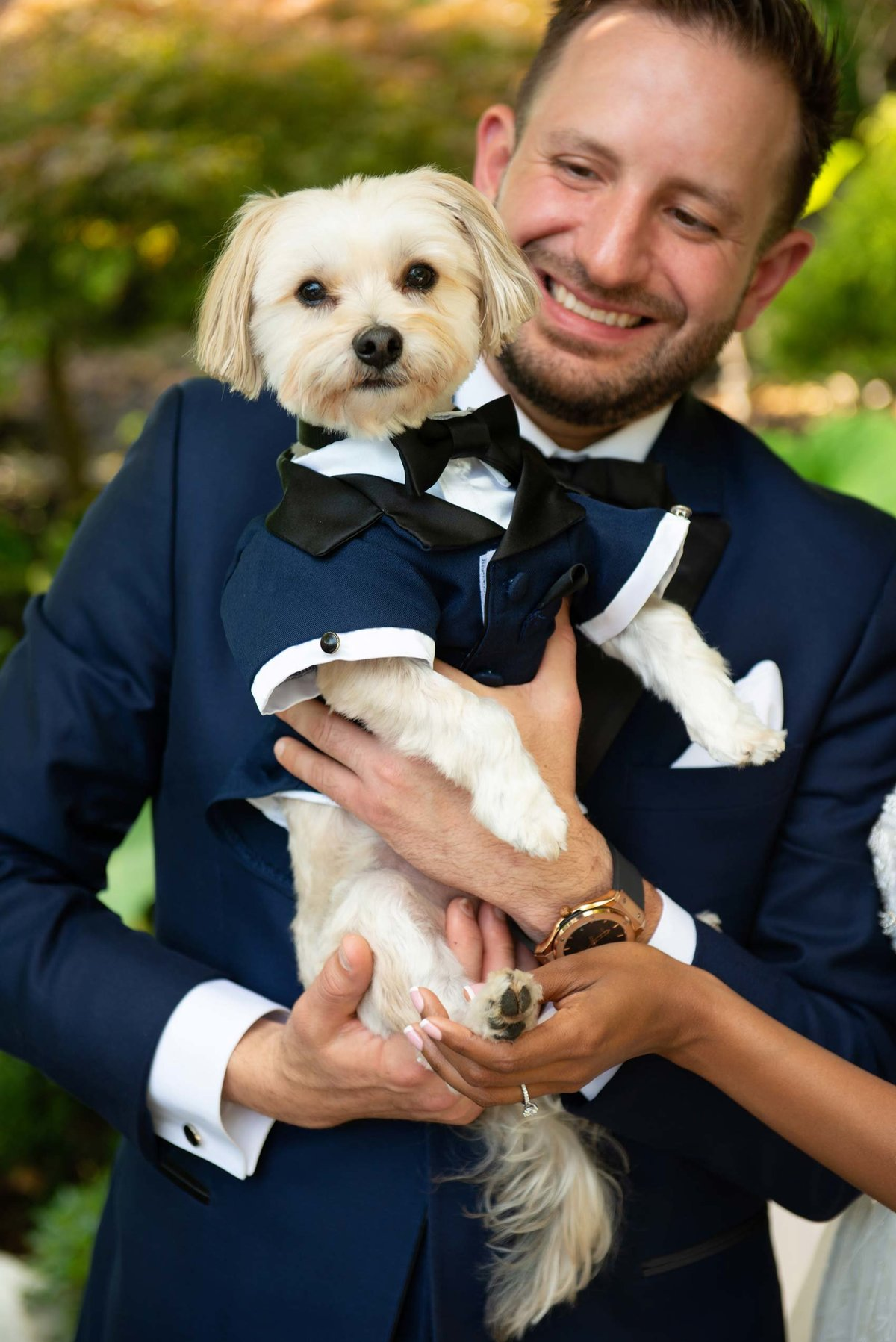 Groom holding dog at Fox Hollow