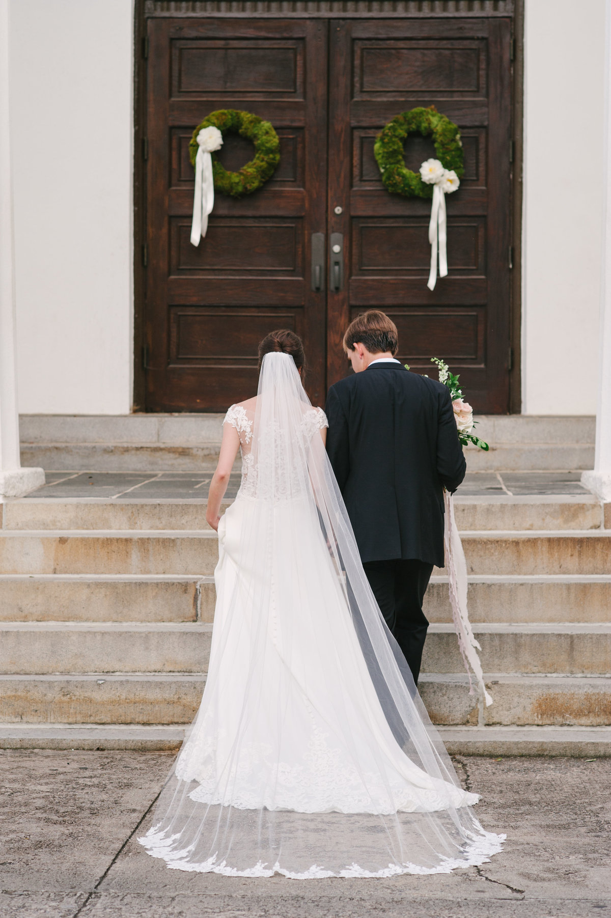 Couple Walking at UGA Chapel Wedding