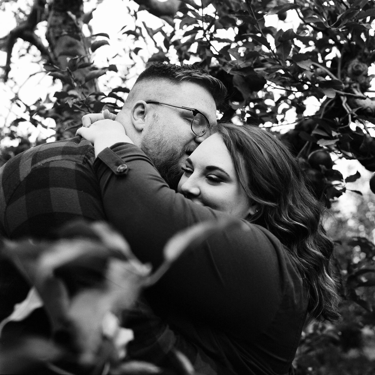 Couple snuggles under the apple trees at Lynds. Photo taken on Tri-X pushed one