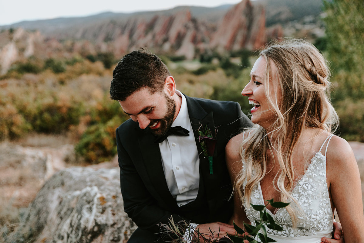 wedding couple laughing at Arrowhead Golf Club in Littleton Colorado