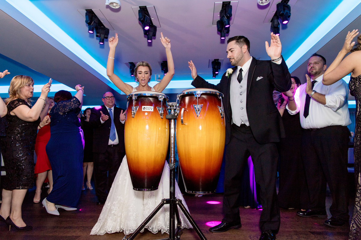 Bride and groom playing the drums at Harbor Club at Prime