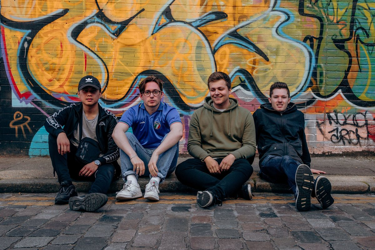 RAMES sat on a curb in Shoreditch during their press shoot