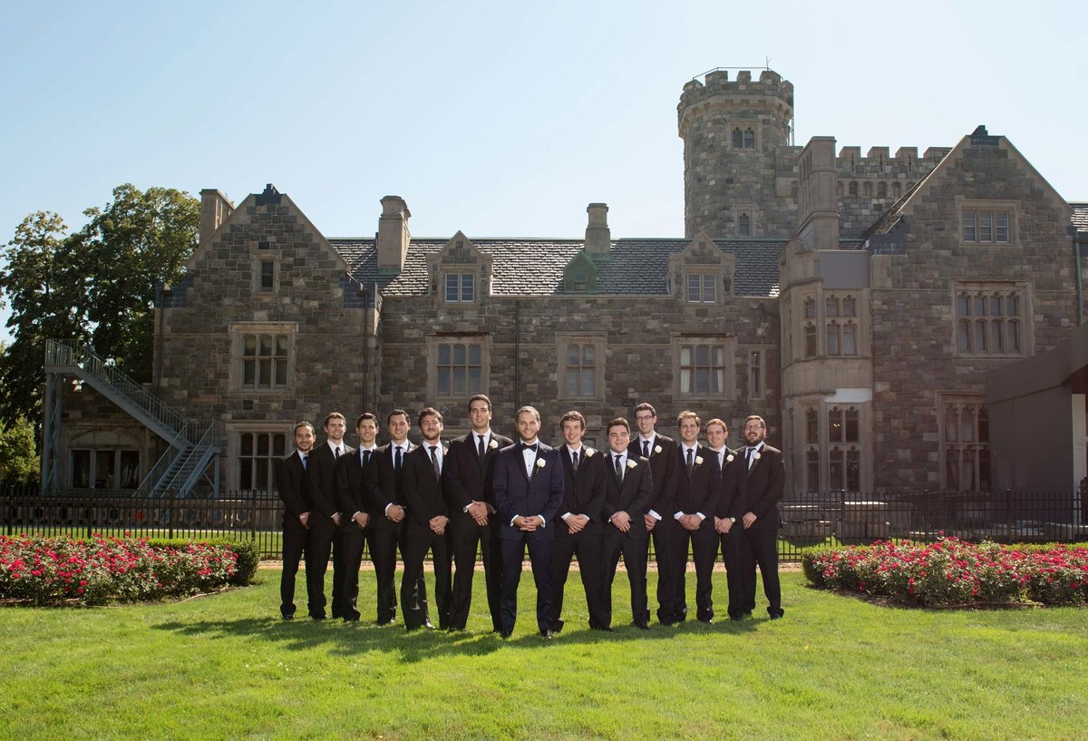 Groom and his groomsmen posing outside of Hempstead House