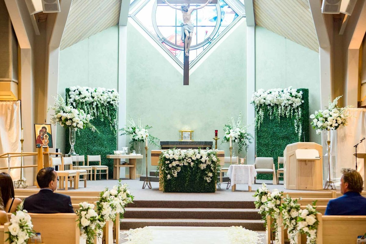 Wedding ceremony church with white and green floral