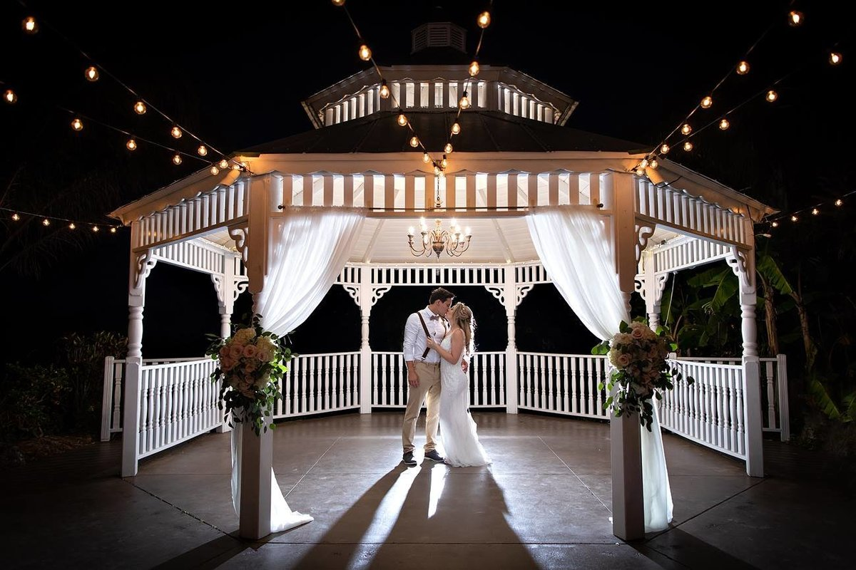 Married couple under a gazebo at night