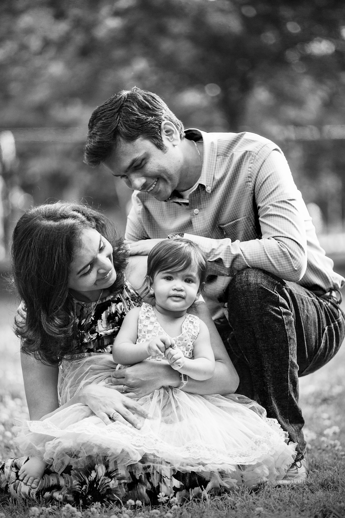 charlotte family photographer creates beautiful black and white portrait of mother and father with daughter on her one year birthday