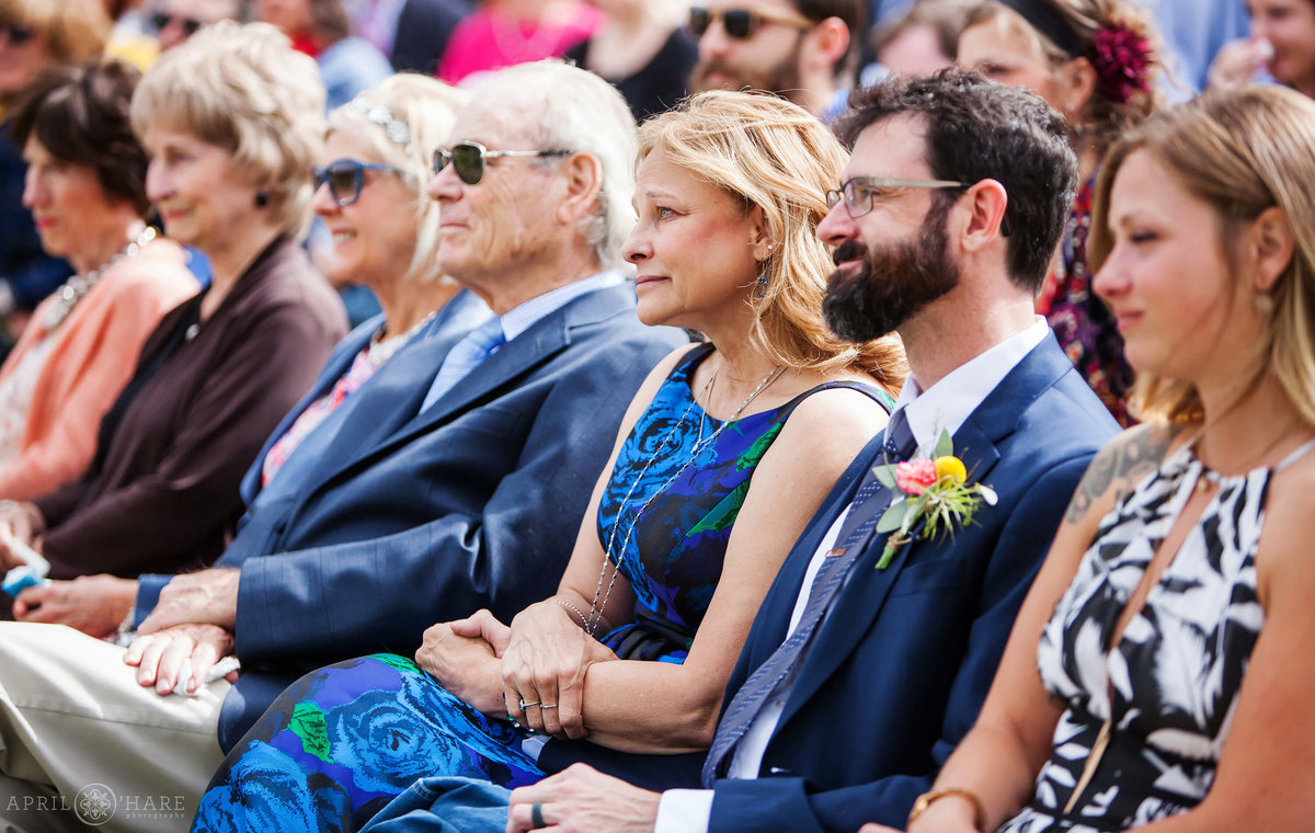Wedding guests look on at wedding ceremony emotionally at B Lazy 2 Ranch in Fraser Colorado