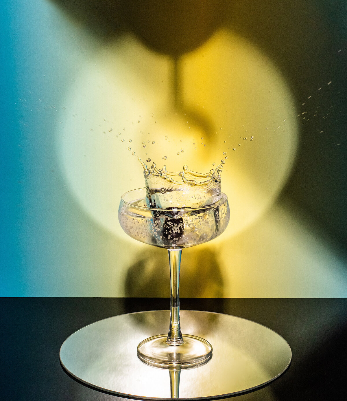 a splash into a cocktail glass