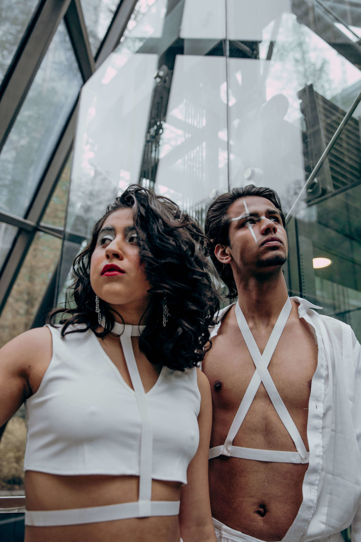 Cherie and Saad stood in a glass structure wearing all white.