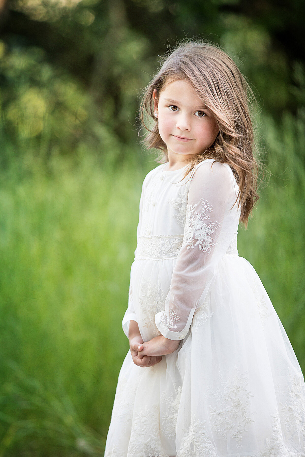 Brown haired girl in white dress, photographed at river front park in billings montana.