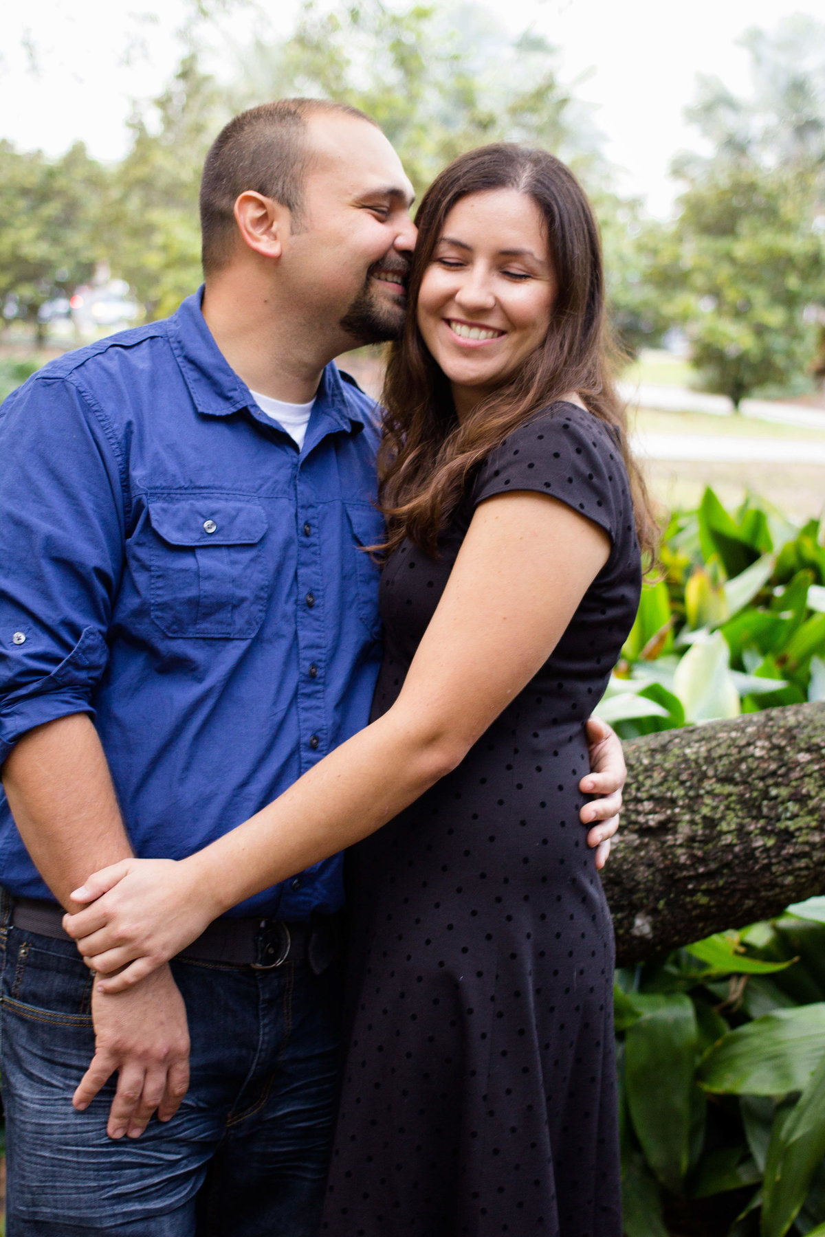Couple snuggles in close for their engagement photos in Tampa, Florida
