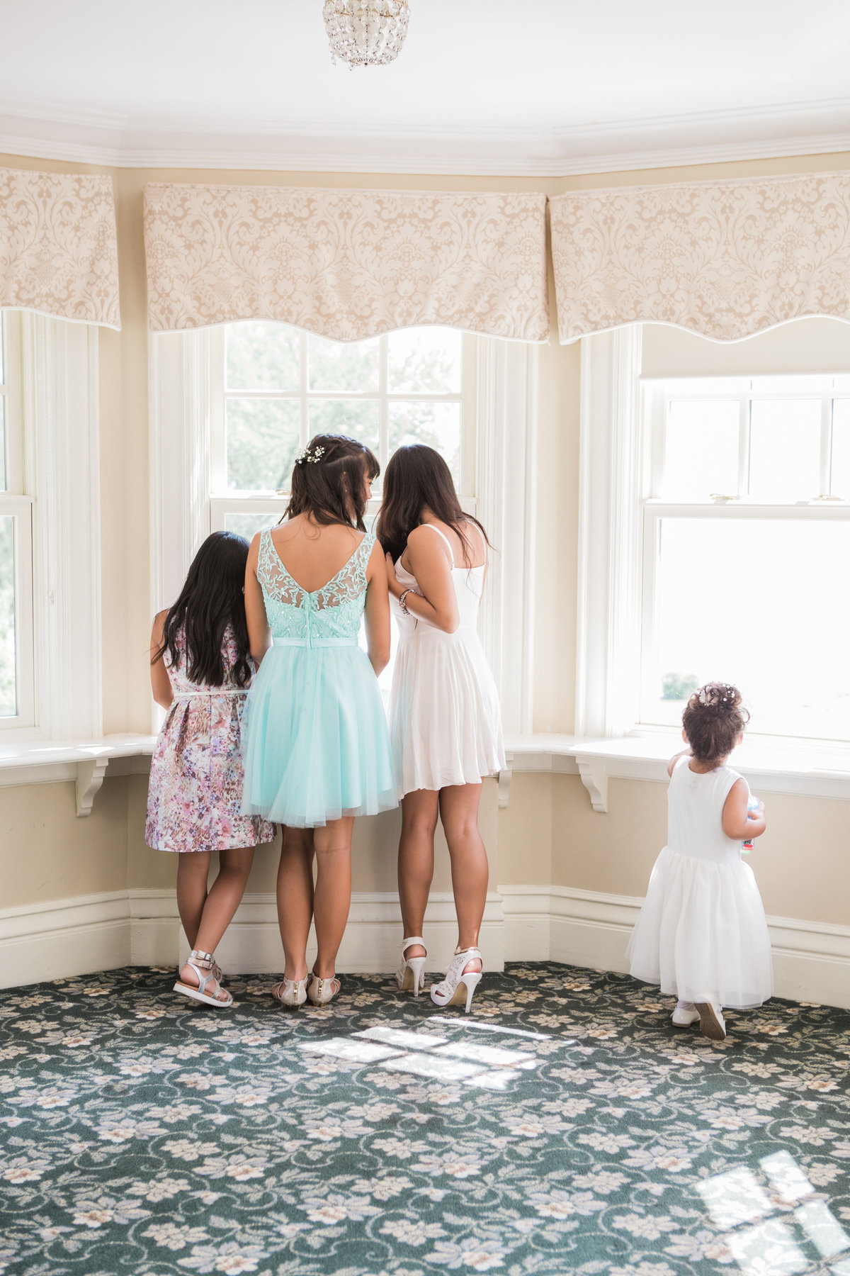 Burlington-wedding-photographer-paletta-mansion-Bridesmaids-looking-out-window
