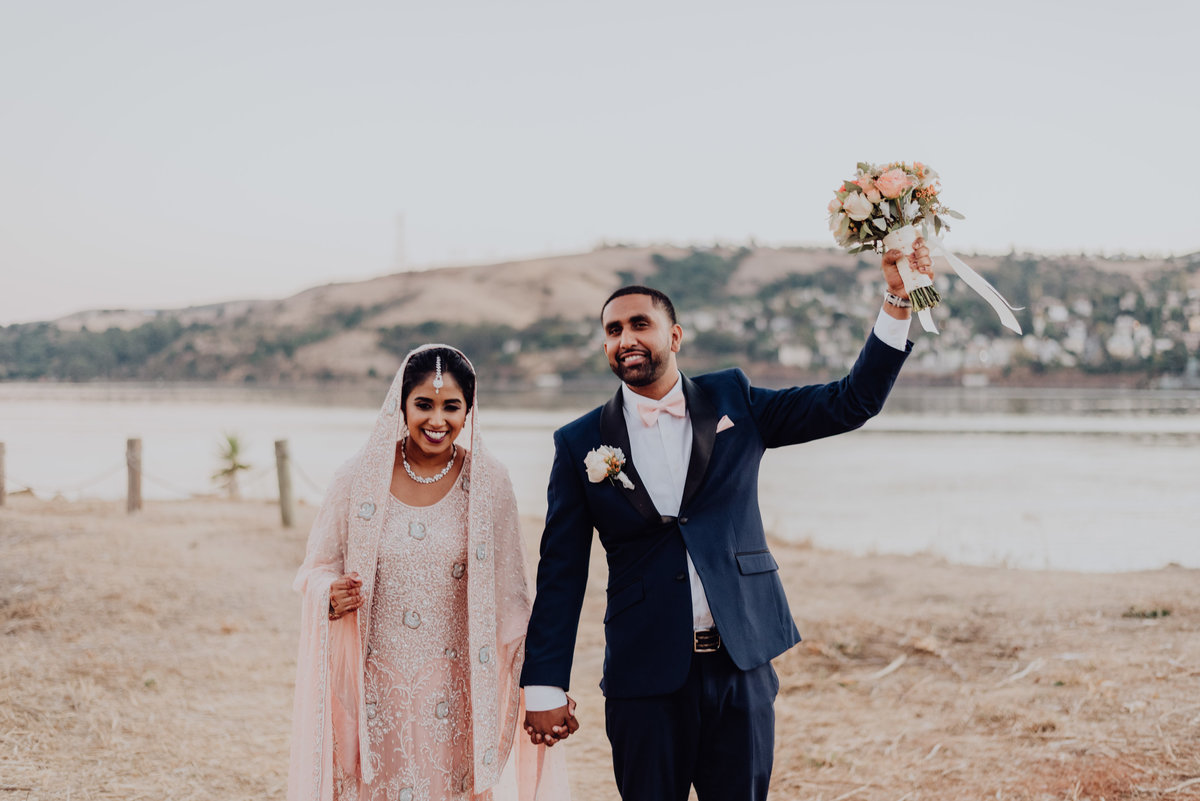 Indian bride and groom holding hands - By Sunshine Shannon Photography