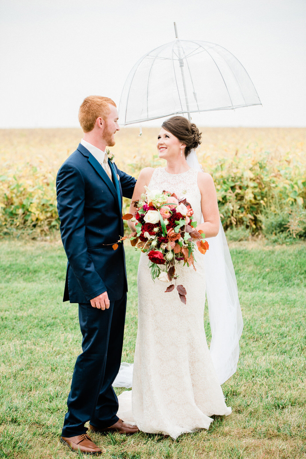 bride and groom photos in the rain