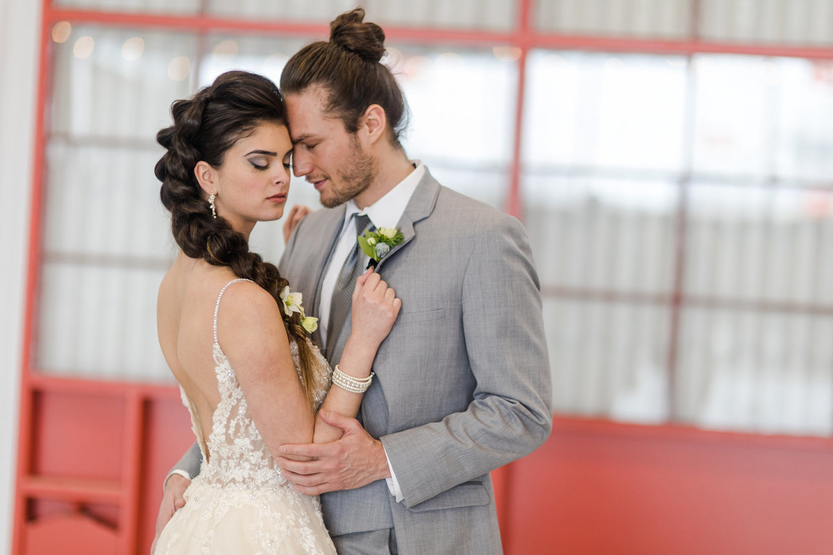 bride with faux hawk and groom with man bun
