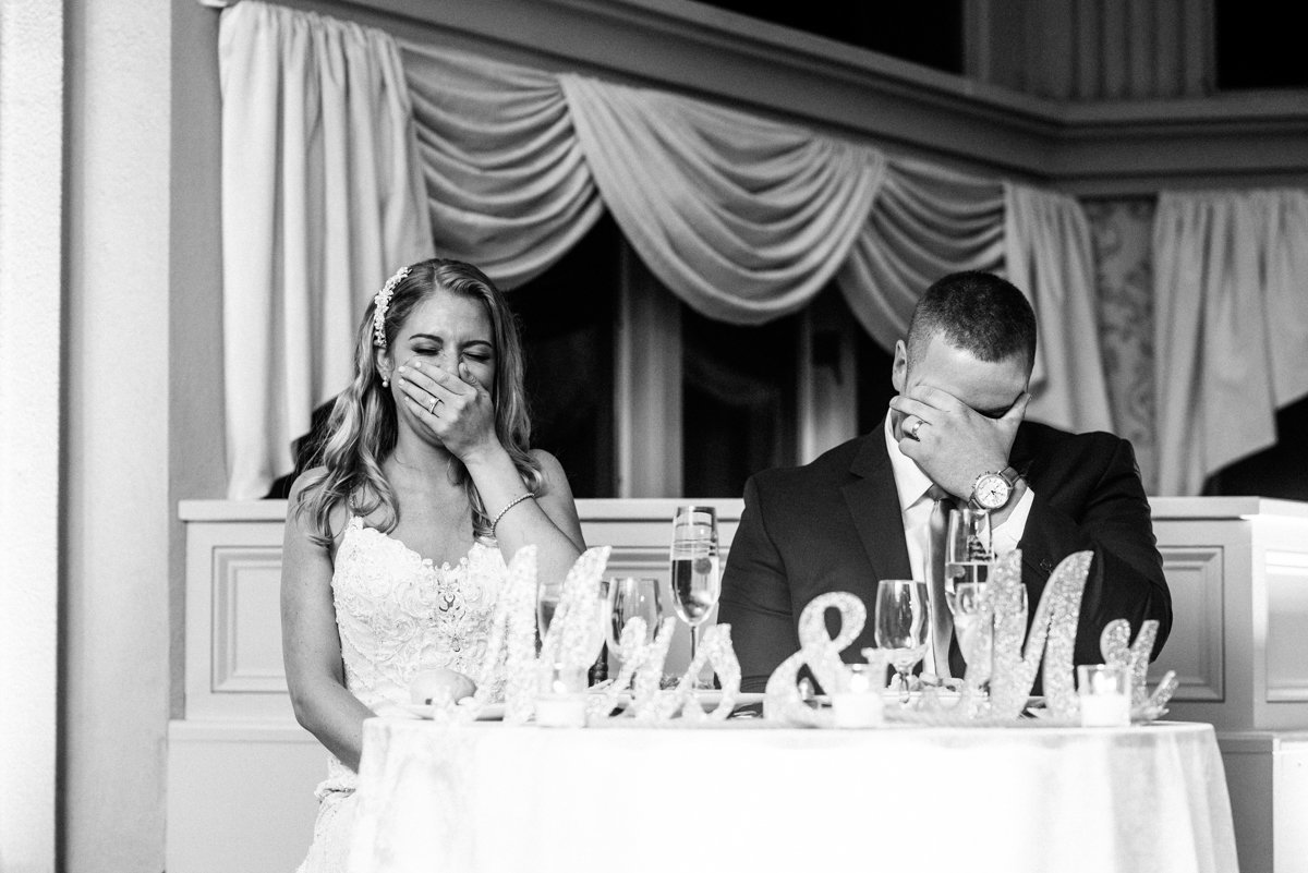 Couple laughing during wedding toasts