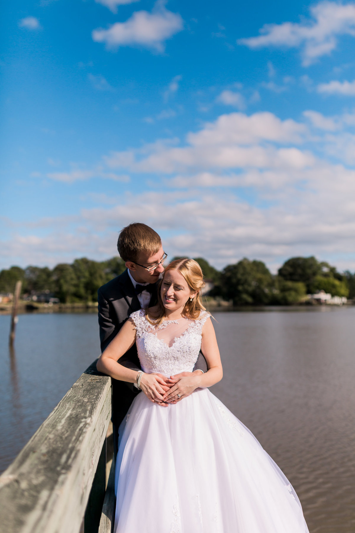 A groom hugs his bride at Fort Eustis