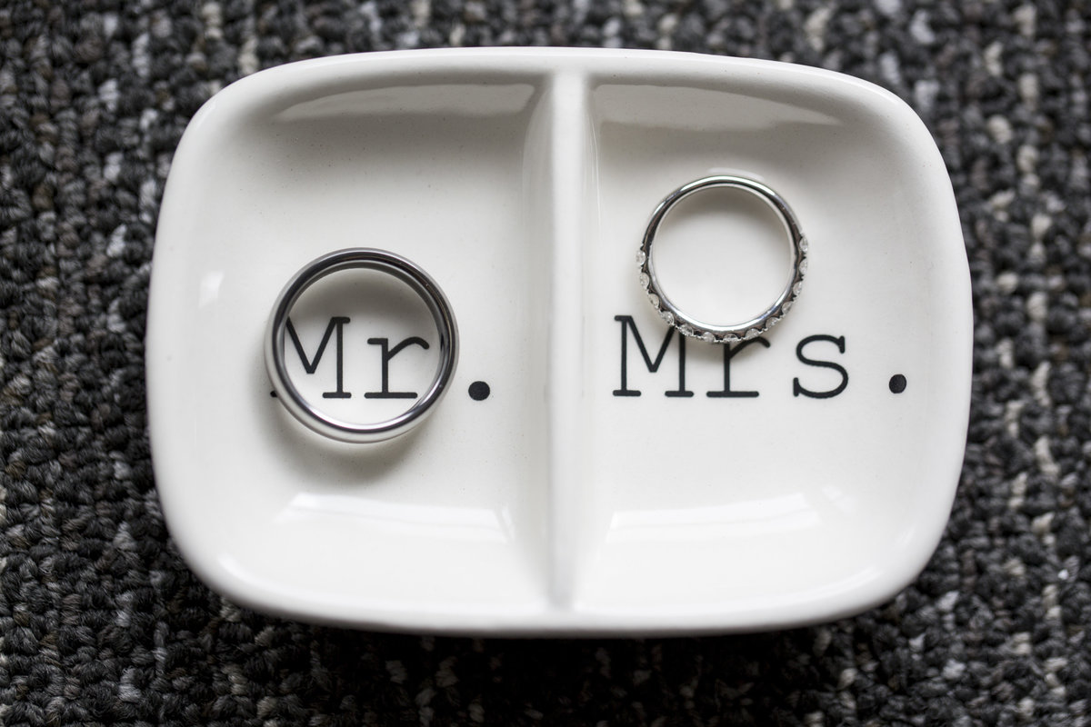 his and hers wedding rings in  dish