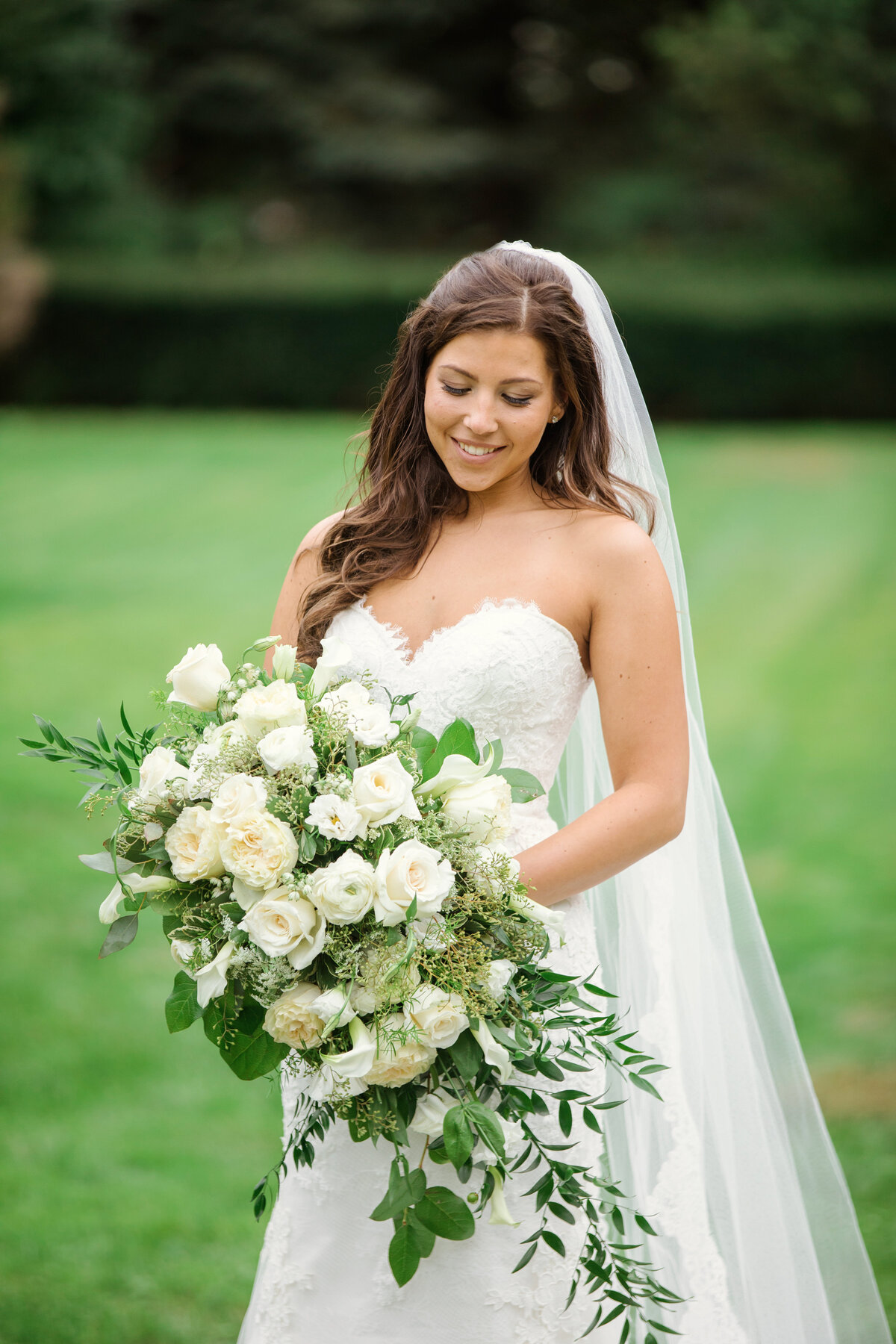 photo of bride looking down at bouquet from wedding at The Carltun