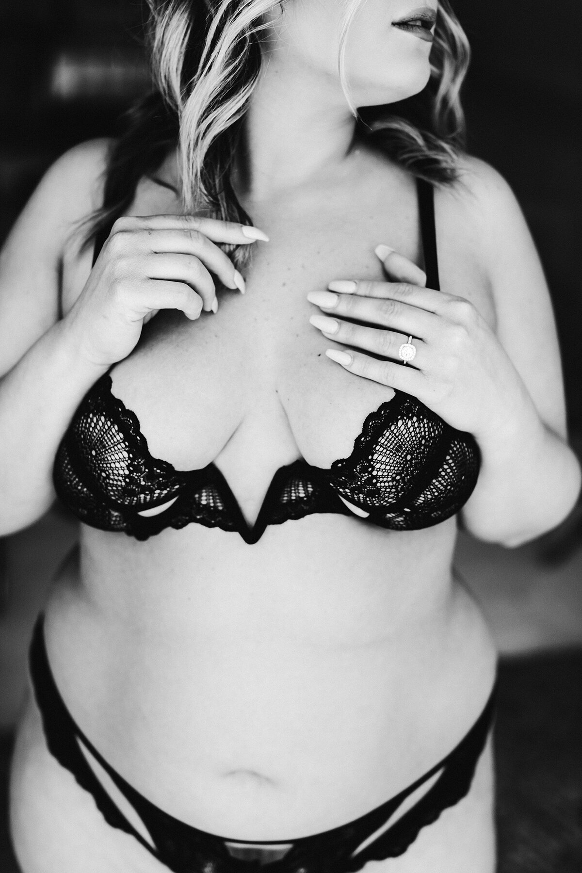 A moody black and white boudoir photo