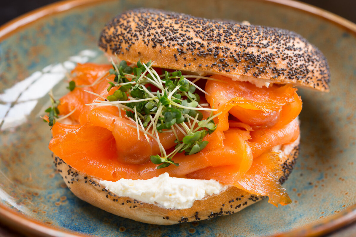 smoked salmon and cream cheese bagel with sesame seeds
